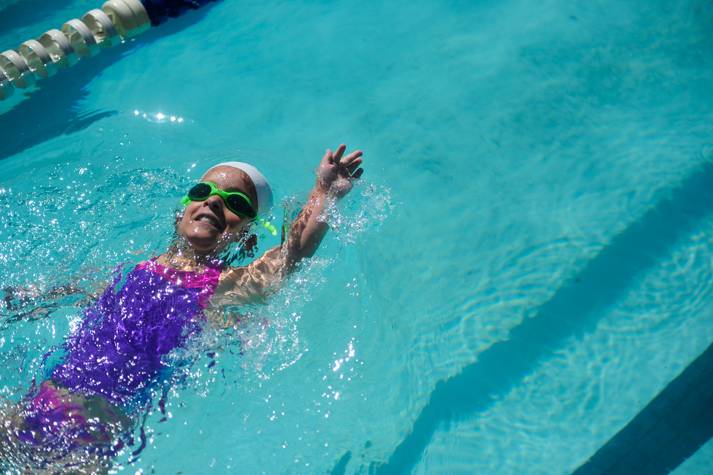 . DENVER - JUNE 19: Mia Towl, 9, practices at Point Athletic Club on June 19, 2013. Towl swims three to four times a week and will soon start training everyday for the 2013 Dwarf Games in Lansing Michigan. (Photo By Grant Hindsley/The Denver Post)