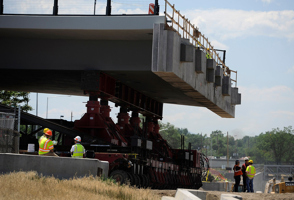 . DENVER, CO - JULY 20: Closing I-70 in both directions over the weekend, the Colorado Department of Transportation (CDOT) will roll the new 2,400-ton Pecos Street bridge (that will go over I-70) approximately 800 feet down I-70 using a Self Propelled Modular Transporter - the first time this method has ever been used by CDOT. The bridge will make a 180 degree turn before being set in to its final resting place. The process will take about 50 hours, with I-70 re-opening on Monday morning. (Photo By Kathryn Scott Osler/The Denver Post)