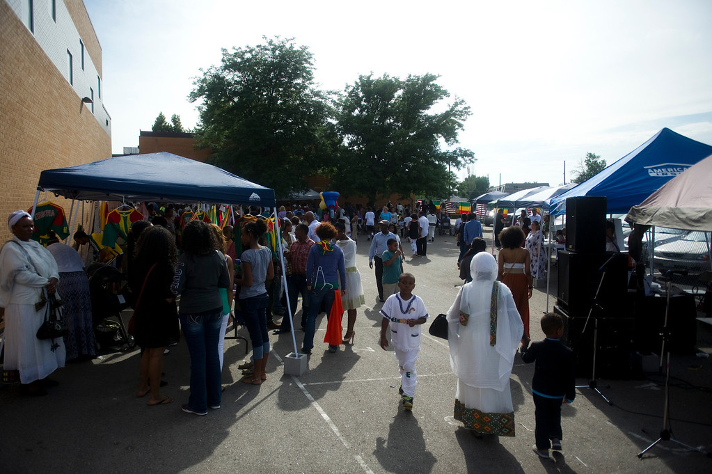 . Patrons walk through the Taste of Ethiopia Grand Festival at Laredo Elementary School in Aurora, Co, on July 28, 2013. (Photo By Grant Hindsley/The Denver Post)