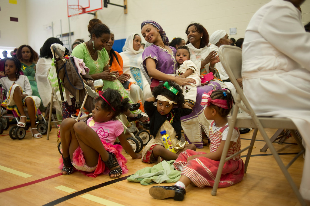 . The audience watches a fashion show of traditional Ethiopian clothing at the Taste of Ethiopia Grand Festival at Laredo Elementary School in Aurora, Co, on July 28, 2013. (Photo By Grant Hindsley/The Denver Post)