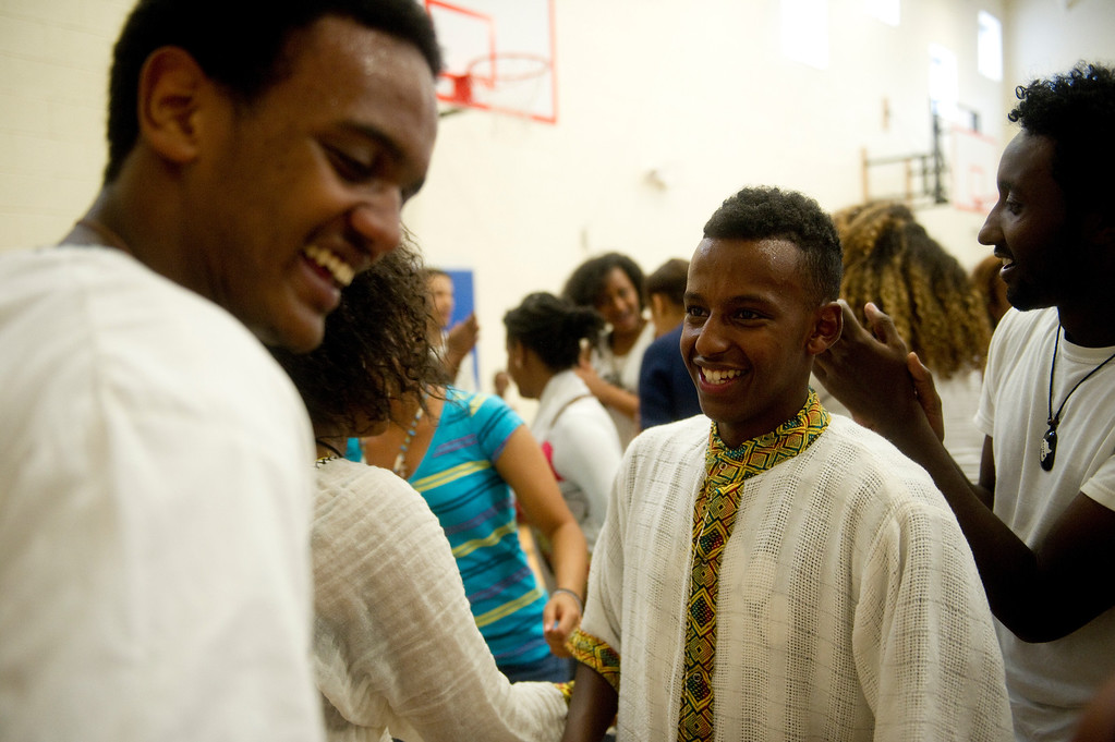 . Nebeu Abraha, left, laughs with Sam Kahsay after finishing their performance at the Taste of Ethiopia Grand Festival at Laredo Elementary School in Aurora, Co, on July 28, 2013. (Photo By Grant Hindsley/The Denver Post)