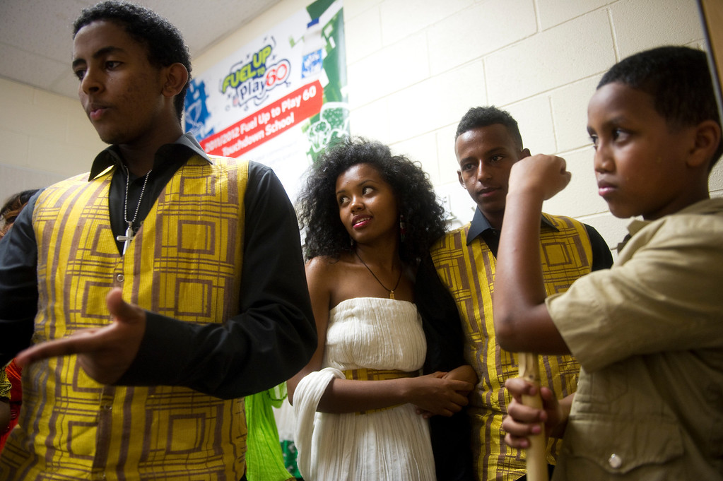 . From left, Abenezer Mergia, Kidest Mulu, Sam Kahsay and Fiker Osman, wait to go on stage before a fashion show of traditional Ethiopian clothing at the Taste of Ethiopia Grand Festival at Laredo Elementary School in Aurora, Co, on July 28, 2013. (Photo By Grant Hindsley/The Denver Post)