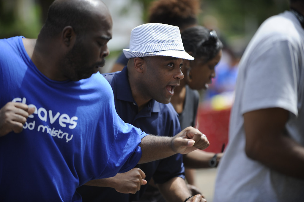 """. DENVER, CO. - AUG 3: Mayor Michael Hancock joins various events around Denver, CO on Aug. 3, 2013. The city is celebrating the first annual \""""Denver Days,\"""" a creation of Mayor Hancock.     Mayor Michael Hancock dances to the Electric Slide during the festivities at Cleave Memorial Church\'s back to school extravaganza.   (Photo By Erin Hull/The Denver Post)"""