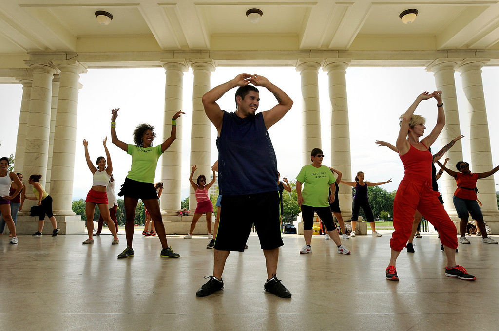 ". Troy Valdez, center, a dance enthusiast who\'s competed, dances with a large group of people on August 18 during Salsa Central Denver\'s ""Summer Salsa and Bachata Bash\"" at Cheesman Park in the Walker Scott Cheesman Pavilion, where instructors helped to rock the dance floor. Photo by Jamie Cotten, Special to The Denver Post"