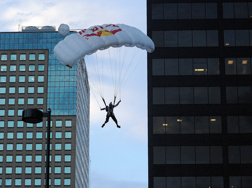 . Jeff Provenzano came in for a smooth landing Tuesday night after he and BASE jumping partner Miles Daisher lept off the top of the Four Seasons Hotel in downtown Denver Tuesday night, August 27, 2013 before they each deployed a canopy to make a safe landing in the parking lot. Both athletes are part of the Red Bull Airforce and jumped for a charity event at the hotel.  Photo By Karl Gehring/The Denver Post