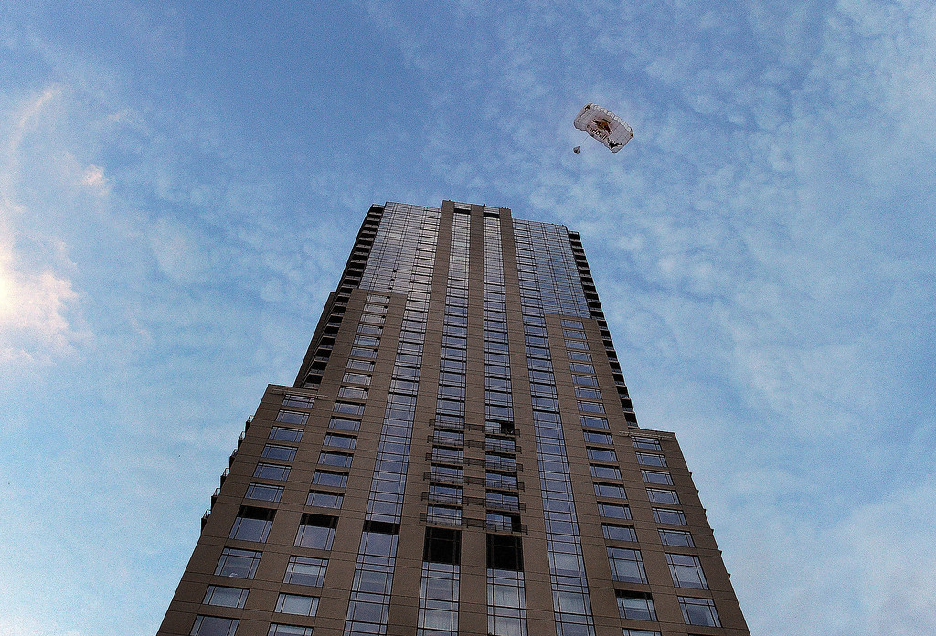 . BASE jumper Miles Daisher leaps off the top of the Four Seasons Hotel in downtown Denver Tuesday night, August 27, 2013.  Photo By Karl Gehring/The Denver Post