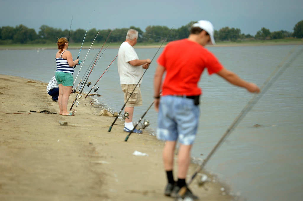 . Anglers line the shores to get in some fishing at Barr Lake on Sunday, September 1, 2013. The draught conditions on the eastern plains are causing farmers to call on the water stored in Barr Lake. Good news for anglers with an appetite: As the water is drawn down to about a quarter of what\'s normally stored there, anglers can fish without limits with a license. (Photo by John Leyba/The Denver Post)
