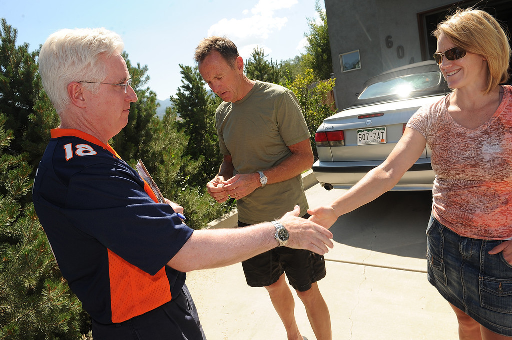 . COLORADO SPRINGS, CO - SEPTEMBER 5, 2013:  Colorado State Senator John Morse, left, who hit the streets  by himself to canvas the West Side neighborhood, talks to Colorado Springs residents Kimball Bayles, middle and his wife Sabrina, right,  about making sure to get out and vote during the recall election next Tuesday  in Colorado Springs, CO on September 5, 2013.  Early voting started in Colorado Springs, CO on Thursday September 5, 2013, to recall State Senator and Senate President John Morse for his support of gun control legislation that passed earlier this year.  Photo by Helen H. Richardson/The Denver Post