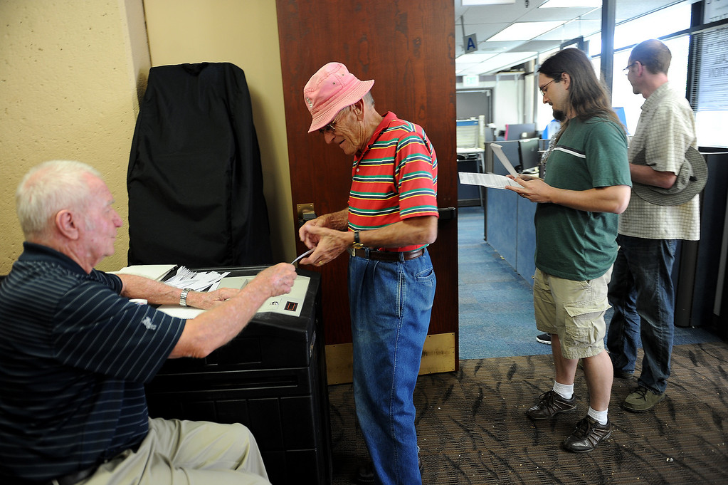 . COLORADO SPRINGS, CO - SEPTEMBER 5, 2013:  Colorado Springs resident Bruce Doyle, middle, casts his vote early during the recall election of State Senator John Morse,  at Centennial Hall at 200 South Cascade in Colorado Springs, CO on Thursday September 5, 2013.  Early voting started in Colorado Springs, CO on Thursday September 5, 2013, to recall State Senator and Senate President John Morse for his support of gun control legislation that passed earlier this year.  Photo by Helen H. Richardson/The Denver Post