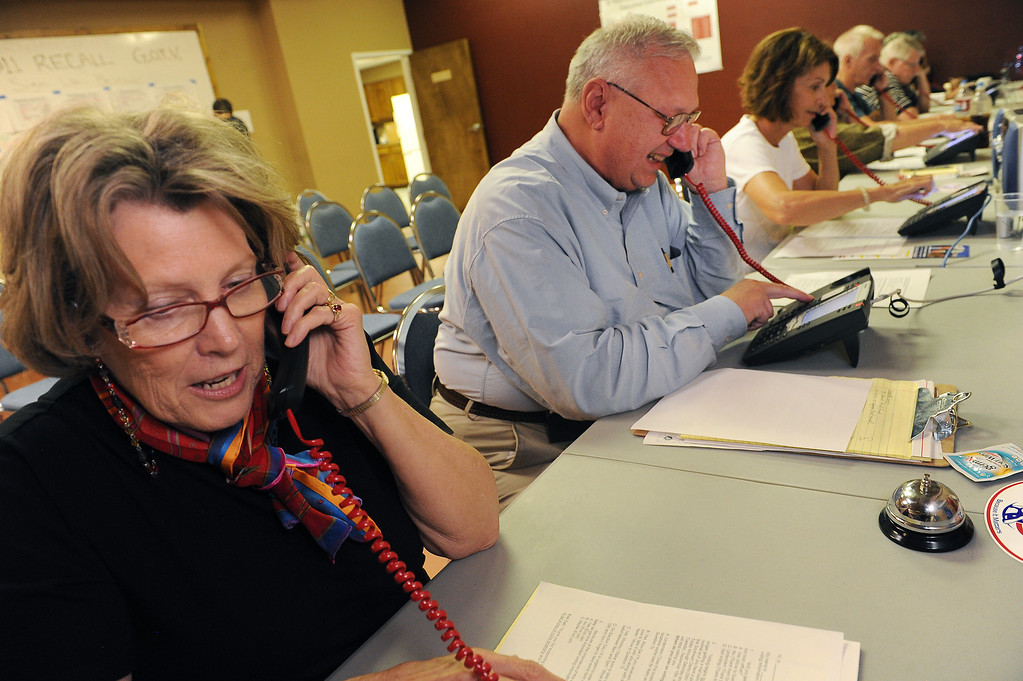 . COLORADO SPRINGS, CO - SEPTEMBER 5, 2013:  Bernie Herpin, second from left, mans the phones at the GOP Headquarters in Colorado Springs, CO on Thursday September 5, 2013.  He and his supporters will be on the phones until Tuesday trying to get out the vote to recall State Senator and Senate President John Morse for his support of gun control legislation that passed earlier this year.  Photo by Helen H. Richardson/The Denver Post