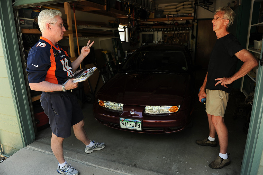 . COLORADO SPRINGS, CO - SEPTEMBER 5, 2013:  Colorado State Senator John Morse, left, who hit the streets  by himself to canvas the West Side neighborhood, talks to Colorado Springs resident Gary Johnson, right about making sure to get out and vote during the recall election next Tuesday  in Colorado Springs, CO on September 5, 2013.  Early voting started in Colorado Springs, CO on Thursday September 5, 2013, to recall State Senator and Senate President John Morse for his support of gun control legislation that passed earlier this year.  Photo by Helen H. Richardson/The Denver Post
