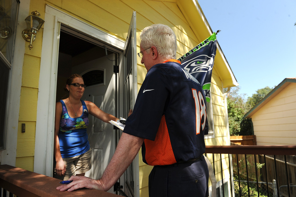 . COLORADO SPRINGS, CO - SEPTEMBER 5, 2013:  Colorado State Senator John Morse, right,  who hit the streets  by himself to canvas the West Side neighborhood, talks to Colorado Springs resident Janessa Goodson, right about making sure to get out and vote during the recall election next Tuesday  in Colorado Springs, CO on September 5, 2013.  Early voting started in Colorado Springs, CO on Thursday September 5, 2013, to recall State Senator and Senate President John Morse for his support of gun control legislation that passed earlier this year.  Photo by Helen H. Richardson/The Denver Post