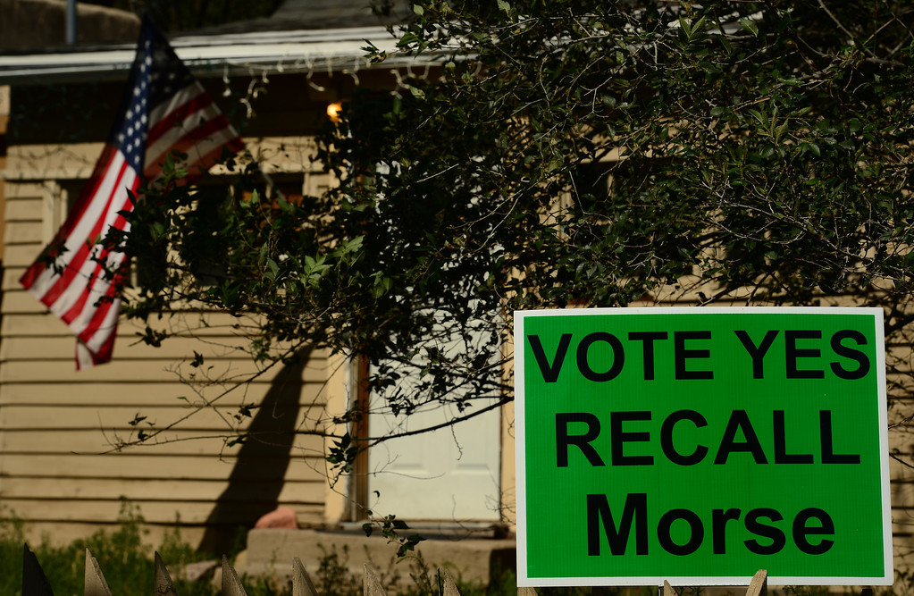 . COLORADO SPRINGS, CO - SEPTEMBER 5, 2013:  Signs in the West Side neighborhood of Colorado Springs, CO call for the recall of Colorado State Senator John Morse,  in Colorado Springs, CO on September 5, 2013.  Early voting started in Colorado Springs, CO on Thursday September 5, 2013, to recall State Senator and Senate President John Morse for his support of gun control legislation that passed earlier this year.  Photo by Helen H. Richardson/The Denver Post