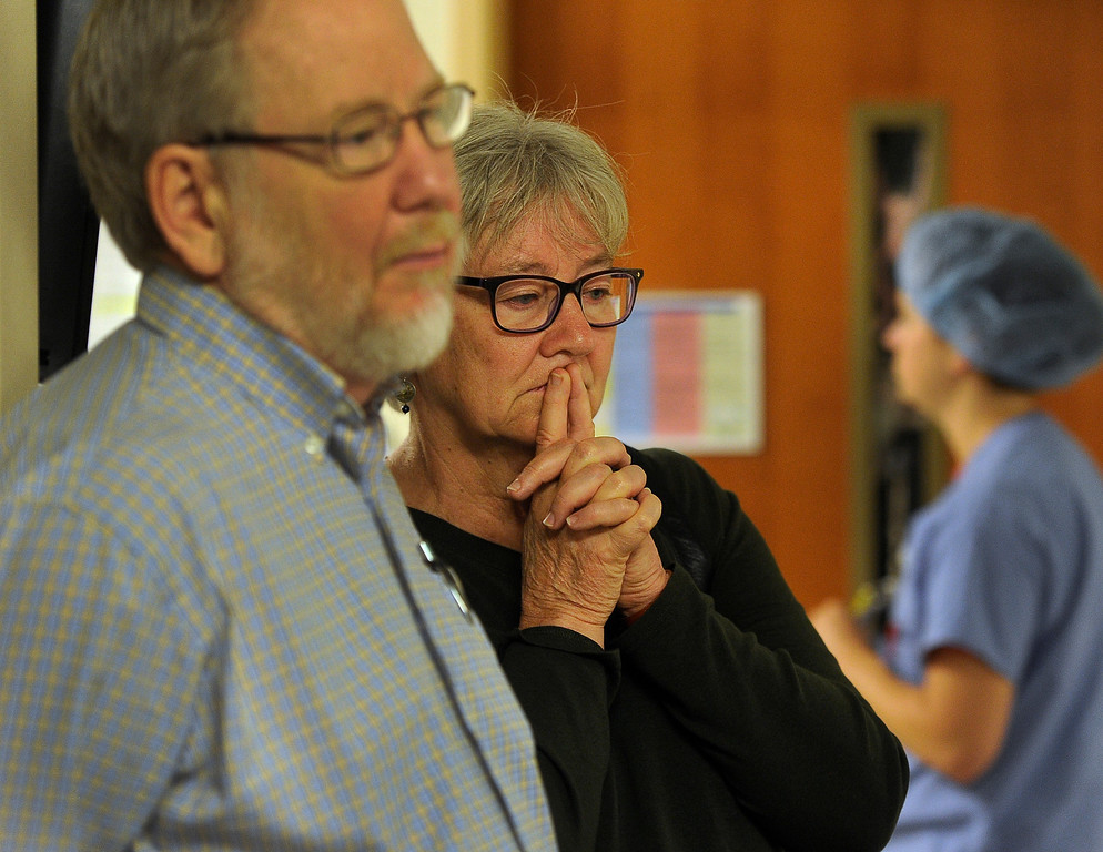 . DENVER, CO - Aug.23: Standing in the hallway just before their daughter Erin Rollman is wheeled in to surgery, parents David and Georgianne listen as the anesthesiologist describes his role during surgery. (Photo By Kathryn Scott Osler/The Denver Post)