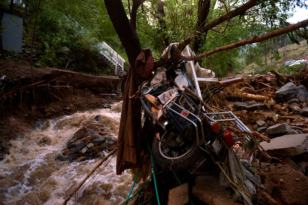 . SALINA, CO. - September 13: A motorcycle stuck in a tree as Salina in 4 Mile Canyon was mostly washed away after heavy rains caused flash flooding and major damage September 13, 2013 Salina, Colorado. (Photo By Joe Amon/The Denver Post)