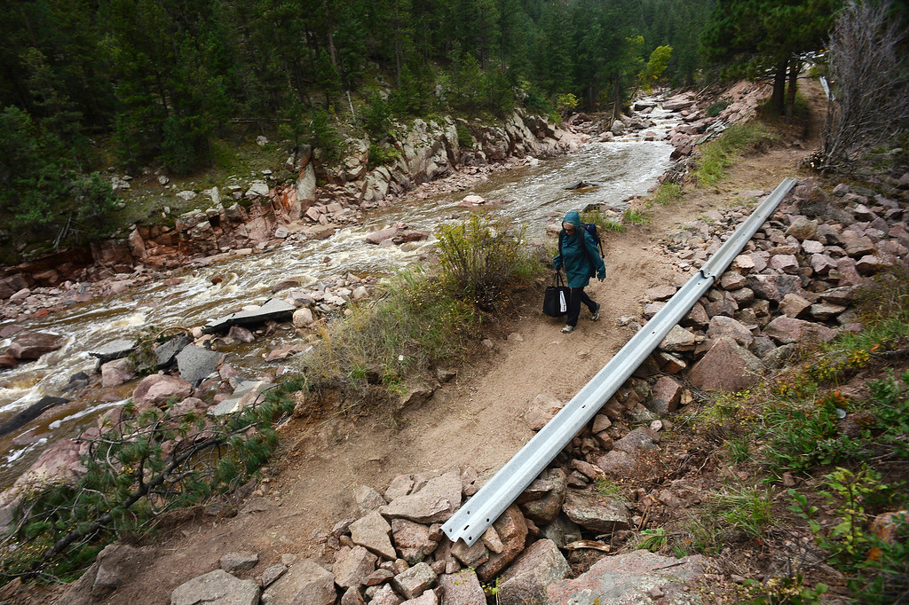 . Pinewood Springs residents use a  new trail next to the Little Thompson River, and what used to be Highway 36, west of Pinewood Springs, Co on September 22, 2013, to ferry goods in and out. as well as to get to and from Estes Park.   (Photo By Helen H. Richardson/ The Denver Post)