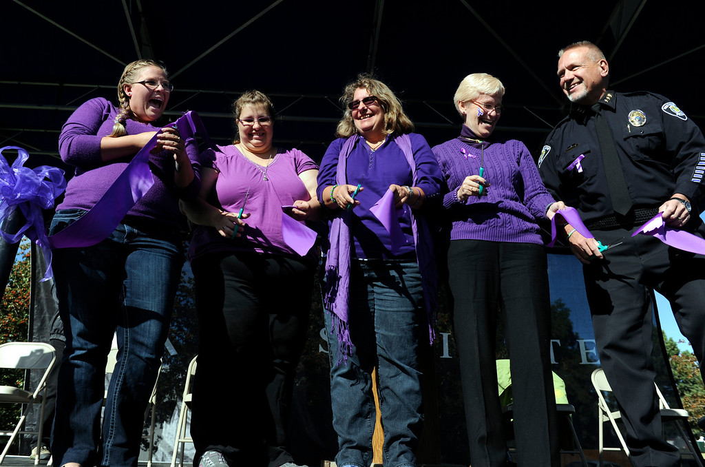 . WESTMINSTER, CO - Oct. 5: From left to right during the ribbon cutting ceremony, Jessica\'s aunt, Rebecca Ridgeway, Jessica\'s mother Sarah Ridgeway, Jessica\'s grandmother Christine Ridgeway, Westminster Mayor Nancy McNally and Westminster Police Chief Lee Birk. A year to the day since Jessica Ridgeway went missing, a dedication ceremony takes place in her memory at the Jessica Ridgeway Memorial Park. Jessica\'s family and hundreds of others gather at the newly renovated park (much of the playground equipment made in Jessica\'s favorite color purple) that came together through the dedication of volunteers throughout the community. (Photo By Kathryn Scott Osler/The Denver Post)