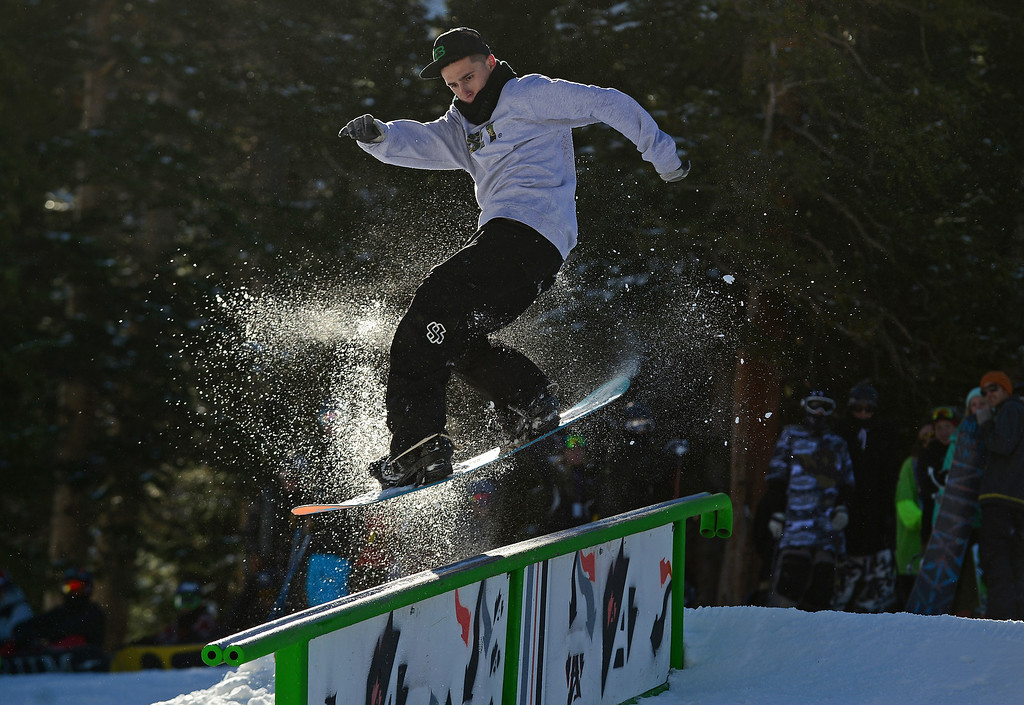 . Santiago Luque, of Breckenridge, tackles the rails at the terrain park at Arapahoe Basin Ski area in Colorado on October 13, 2013.  Arapahoe Basin ski area becomes the first ski area in the nation to open for the 2013-14 ski season.   The area, taking advantage of early now fall and cold conditions favorable for making snow, opened four days later than it\'s earliest opening ever on October 9th, but it is still very early. Loveland Ski Area hopes to be next in line to open for the year.  Thousands of skiers turned out for the opening of the lifts at 8:30 am.   (Photo By Helen H. Richardson/ The Denver Post)