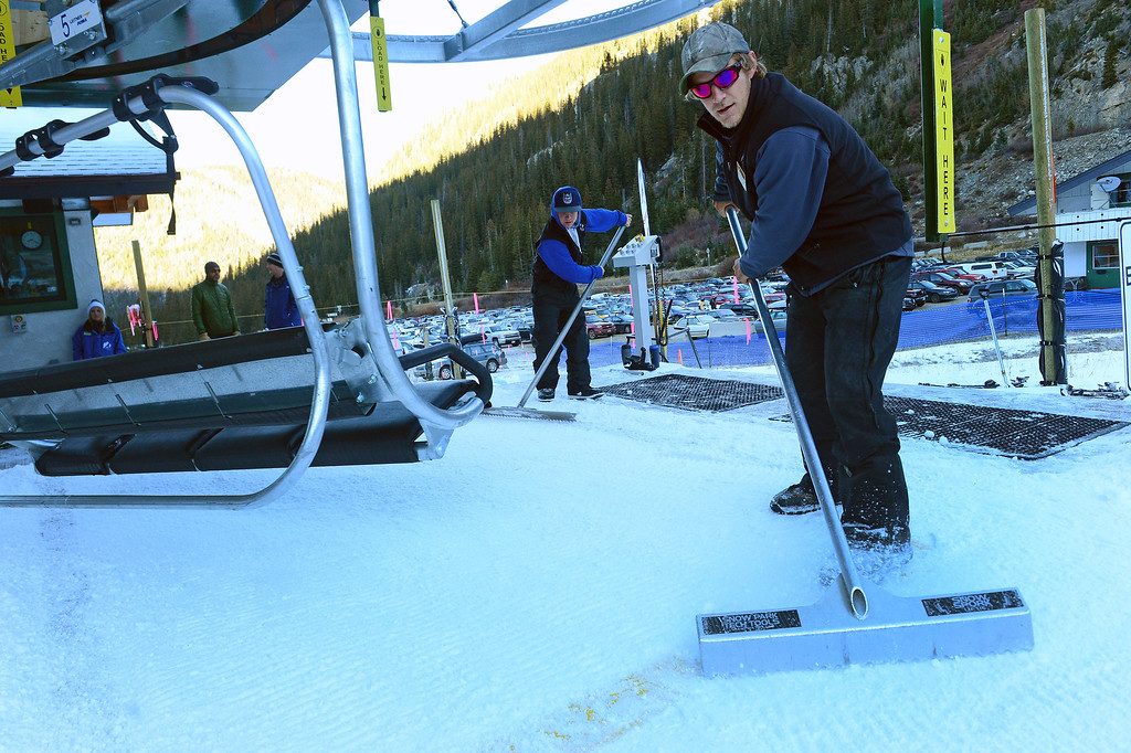 . John Carson scrapes snow before the lifts open at Arapahoe Basin ski areain Arapahoe Basin, CO on October 13,  2013.  The area, taking advantage of early now fall and cold conditions favorable for making snow, opened four days later than it\'s earliest opening ever on October 9th, but it is still very early. Loveland Ski Area hopes to be next in line to open for the year.  Thousands of skiers turned out for the opening of the lifts at 8:30 am.   (Photo By Helen H. Richardson/ The Denver Post)