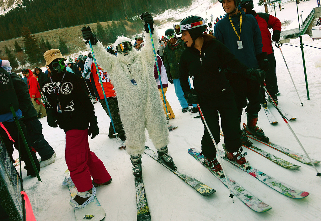 . Sierra Castillo dressed in a costume as she lined up for the first run of the year at Arapahoe Basin Ski area in Colorado on October 13, 2013.  Arapahoe Basin ski area becomes the first ski area in the nation to open for the 2013-14 ski season.   The area, taking advantage of early now fall and cold conditions favorable for making snow, opened four days later than it\'s earliest opening ever on October 9th, but it is still very early. Loveland Ski Area hopes to be next in line to open for the year.  Thousands of skiers turned out for the opening of the lifts at 8:30 am.   (Photo By Helen H. Richardson/ The Denver Post)