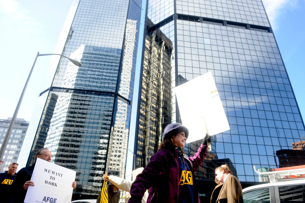 . DENVER, CO: Oct. 16, 2013  Mindy Mohr, an EPA employee, marches with fellow demonstrators outside of the shutdown Housing and Urban Development offices in downtown Denver on Oct. 16, 2013. The group was calling for the government shutdown to end and the debt ceiling to be raised.  (Photo By Erin Hull/The Denver Post)