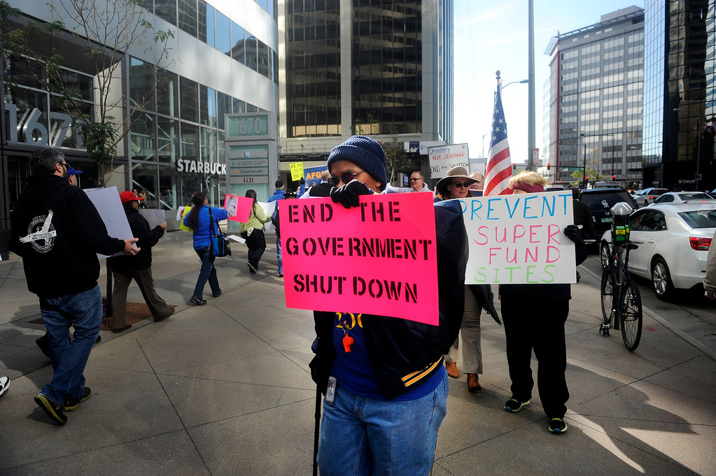 . DENVER, CO: Oct. 16, 2013  Roland Davis, a Housing and Urban Development employee, marched outside the shutdown office in downtown Denver in protest of the government shutdown on Oct. 16, 2013.   (Photo By Erin Hull/The Denver Post)