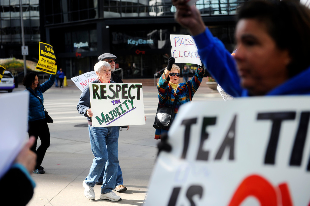 """. DENVER, CO: Oct. 16, 2013  Federal workers, community groups and voters demonstrated in front of the shutdown Housing and Urban Development offices in downtown Denver in protest of the government shutdown on Oct. 16, 2013. They chanted as they marched, calling out \""""We want to work!\""""   (Photo By Erin Hull/The Denver Post)"""