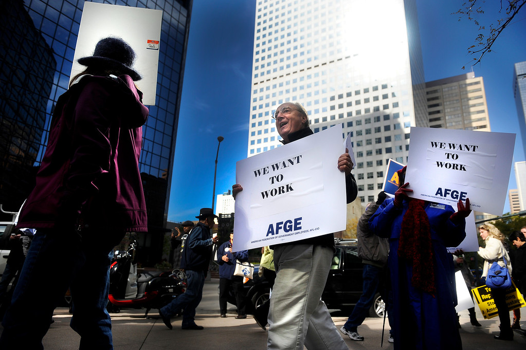 . DENVER, CO: Oct. 16, 2013  Gary Crow-Willard (center) marches outside the shutdown Housing and Urban Development offices on Oct. 16, 2013 in downtown Denver. The group was calling for the end of the government shutdown.    (Photo By Erin Hull/The Denver Post)
