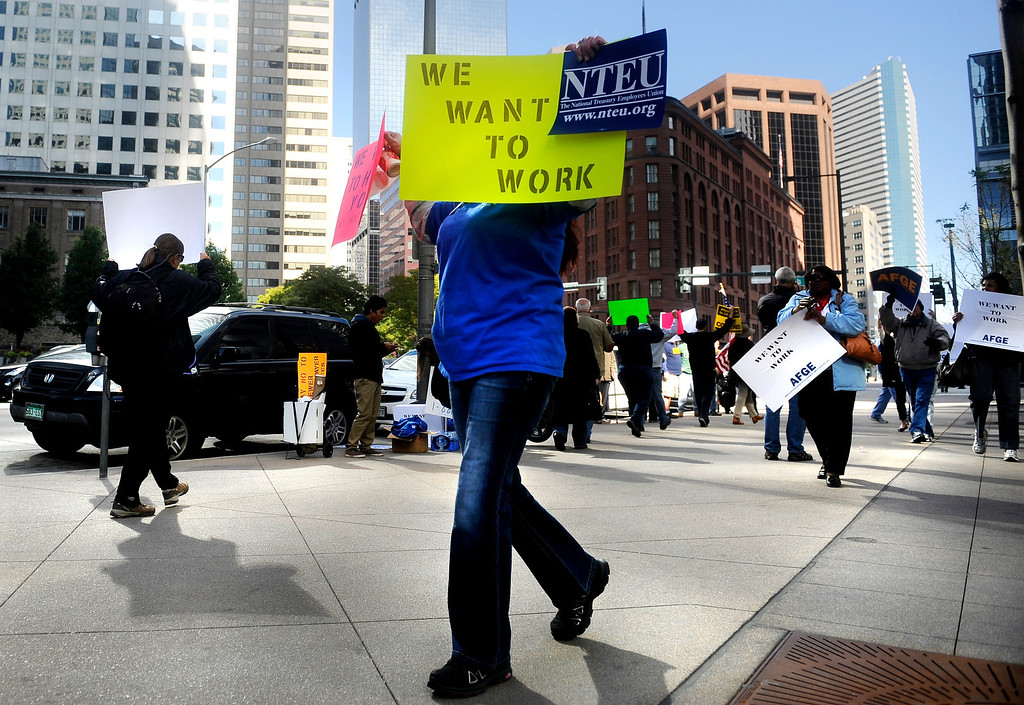 """. DENVER, CO: Oct. 16, 2013  \""""We Want To Work\"""" reads a sign carried by a demonstrator who showed up to march in front of the shutdown Housing and Urban Development offices in downtown Denver on Oct. 16, 2013. The demonstrators called for an end to the government shutdown.  (Photo By Erin Hull/The Denver Post)"""