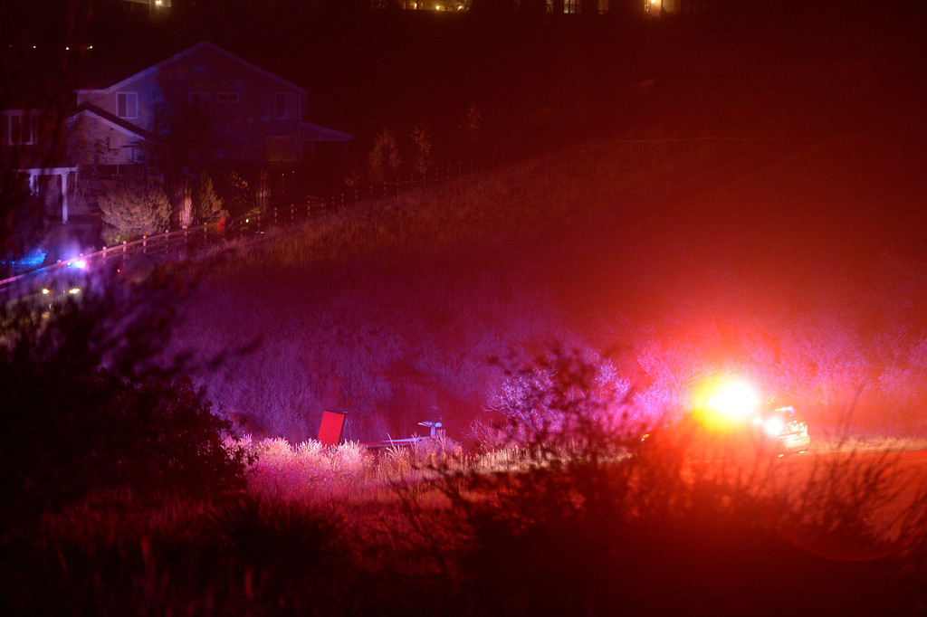 . A small single engine plane sits on its side after crashing in a field just behind some  houses after hitting some power lines October 28, 2013 in dense fog. The pilot was taken to the hospital. (Photo by John Leyba/The Denver Post)