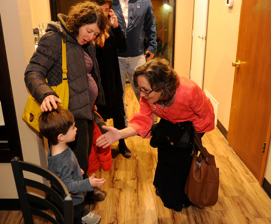 . DENVER, CO - NOVEMBER 5 :   District 3 candidate for the Denver School Board Meg Schomp , right, shakes hands with 2-year -old Isaac Sirota who was with his mom Emily Sirota as Schomp gathered with supporters on Tuesday, November 5, 2013 at Angelo\'s Taverna on 6th Ave. (Photo By Cyrus McCrimmon/The Denver Post)