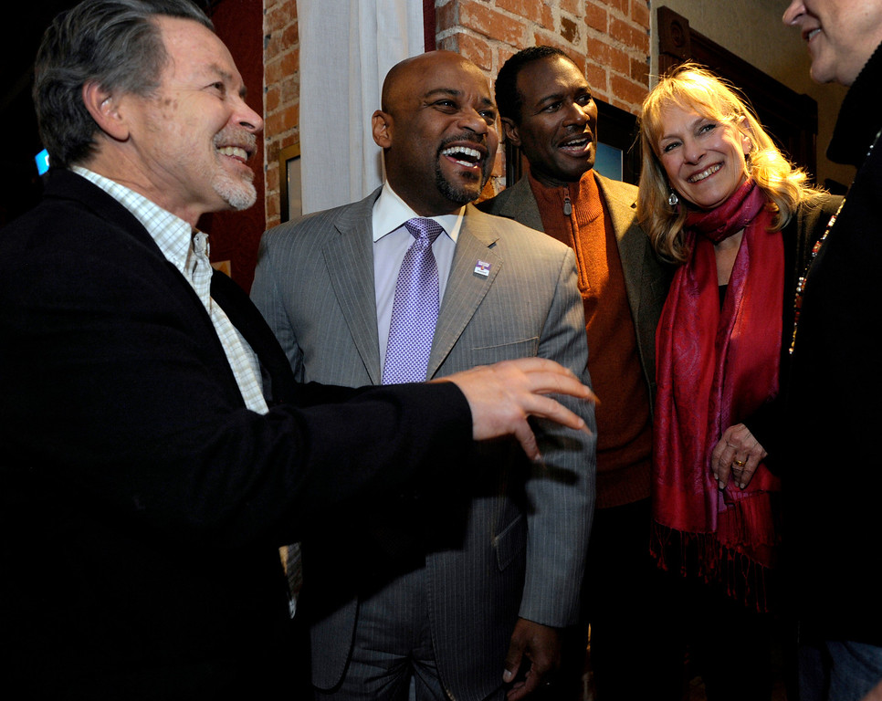 . DENVER, CO - NOV. 5: Denver Mayor Michael Hancock, second from left, congratulates all three new  Denver Public School board members, Mike Johnson, left, Landri Taylor, behind the mayor, and Barbara O\'Brien. Denver Public School Board candidates supporting Superintendent Tom Boasberg\'s reforms host their election night party at the Irish Snug. (Photo By Kathryn Scott Osler/The Denver Post)