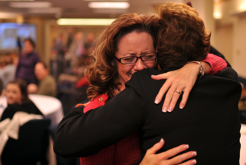 . DENVER, CO. NOVEMBER 05 : Amy Oliver Cooke of the Independence Institute, left, hugs Leslie White during the anti-amendment 66 party at the Independence Institute in Denver, Colorado November 05, 2013. (Photo by Hyoung Chang/The Denver Post)