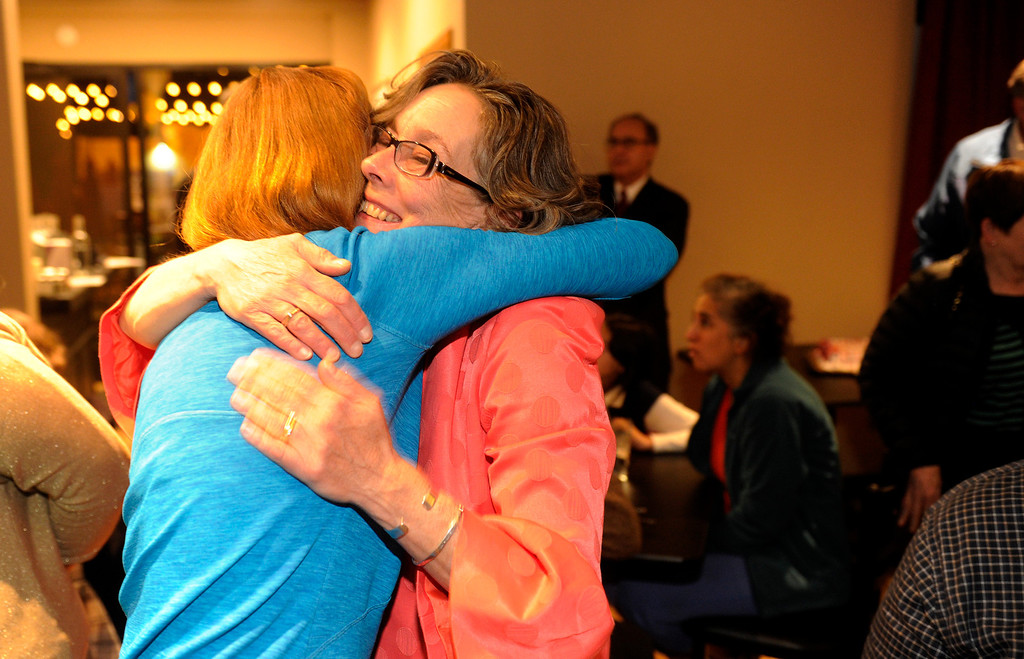 . DENVER, CO - NOVEMBER 5 :   District 3 candidate for the Denver School Board Meg Schomp, right, hugs friend Kathleen Wells as she  gathered with supporters on Tuesday, November 5, 2013 at Angelo\'s Taverna on 6th Ave. (Photo By Cyrus McCrimmon/The Denver Post)