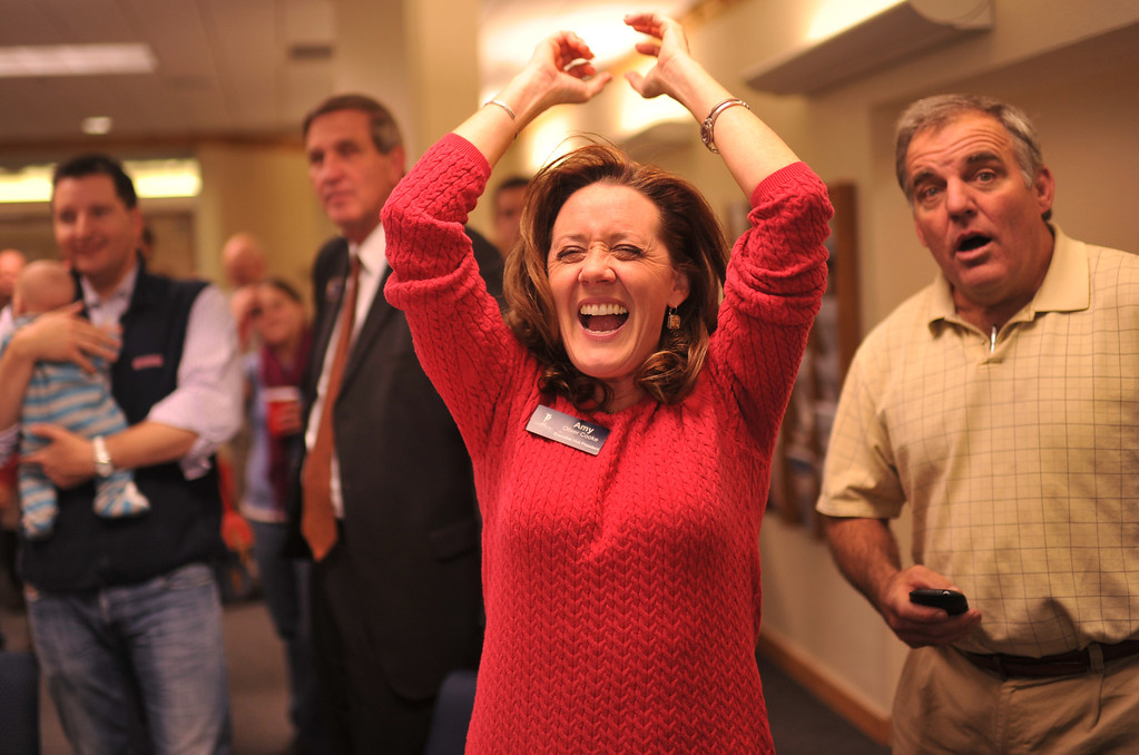 . DENVER, CO. NOVEMBER 05 : Amy Oliver Cooke of the Independence Institute, front, celebrates the result during the anti-amendment 66 party at the Independence Institute in Denver, Colorado November 05, 2013. (Photo by Hyoung Chang/The Denver Post)