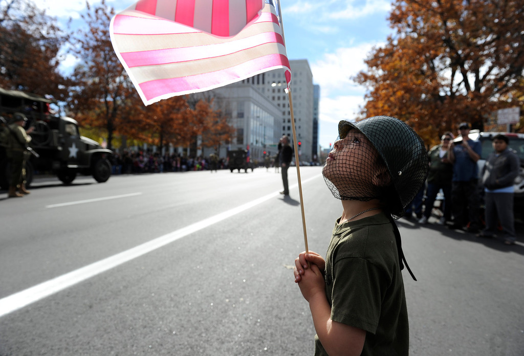 . DENVER, CO - NOV. 9: Leo Hoffman, 5, stands along the parade route on Broadway dressed in his favorite military outfit, complete with a Marines t-shirt and Army dog tags as well as his favorite helmet. The largest annual Denver Veteran\'s Day Celebration takes place starting with a 5k run and continuing with a parade and remembrance ceremony downtown next to Civic Center Park, and finishing on the Auraria campus with activities and fireworks. (Photo By Kathryn Scott Osler/The Denver Post)
