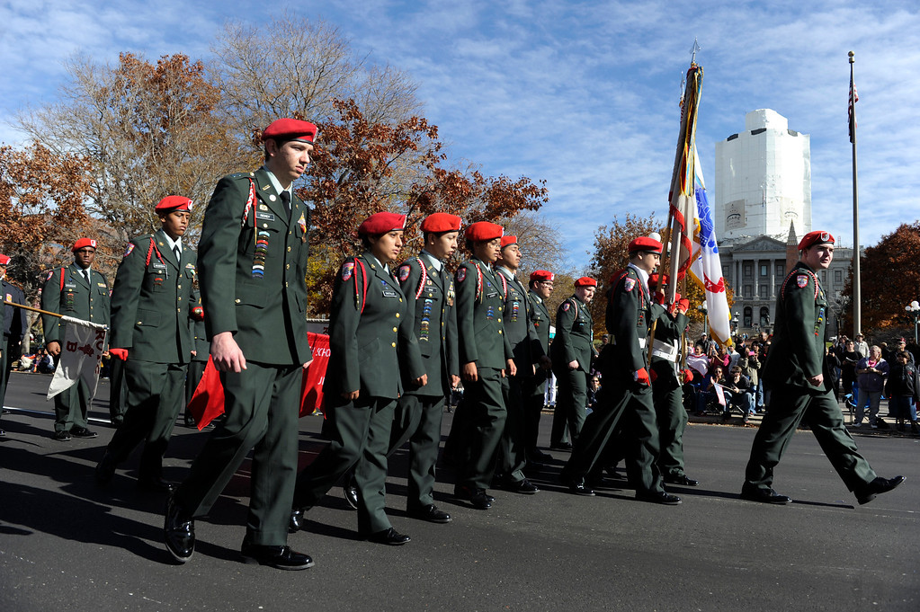 . DENVER, CO - NOV. 9: Members of the East High School ROTC march past the bandstand on Broadway during the parade. The largest annual Denver Veteran\'s Day Celebration takes place starting with a 5k run and continuing with a parade and remembrance ceremony downtown next to Civic Center Park, and finishing on the Auraria campus with activities and fireworks. (Photo By Kathryn Scott Osler/The Denver Post)