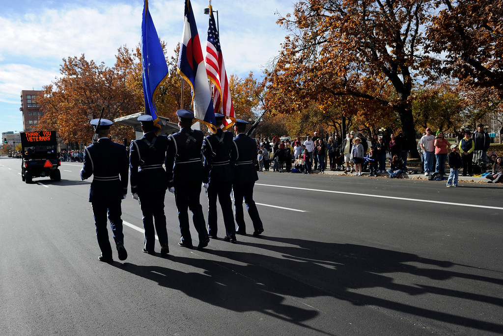 . DENVER, CO - NOV. 9: A color guard from the Peterson Air Force Base walks along Broadway as the largest annual Denver Veteran\'s Day Celebration takes place starting with a 5k run and continuing with a parade and remembrance ceremony downtown next to Civic Center Park, and finishing on the Auraria campus with activities and fireworks. (Photo By Kathryn Scott Osler/The Denver Post)
