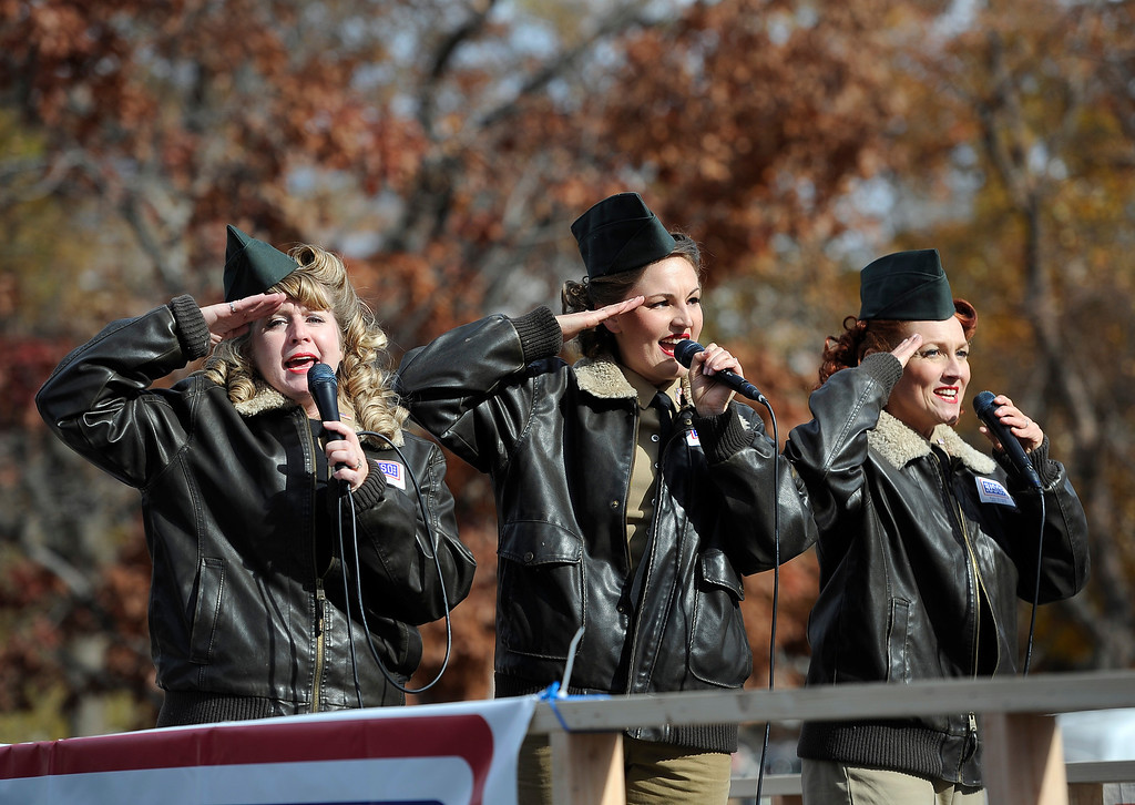 . DENVER, CO - NOV. 9: Members of the Reveille 3, an Andrews Sisters Tribute Act, perform along the parade route. The largest annual Denver Veteran\'s Day Celebration takes place starting with a 5k run and continuing with a parade and remembrance ceremony downtown next to Civic Center Park, and finishing on the Auraria campus with activities and fireworks. (Photo By Kathryn Scott Osler/The Denver Post)