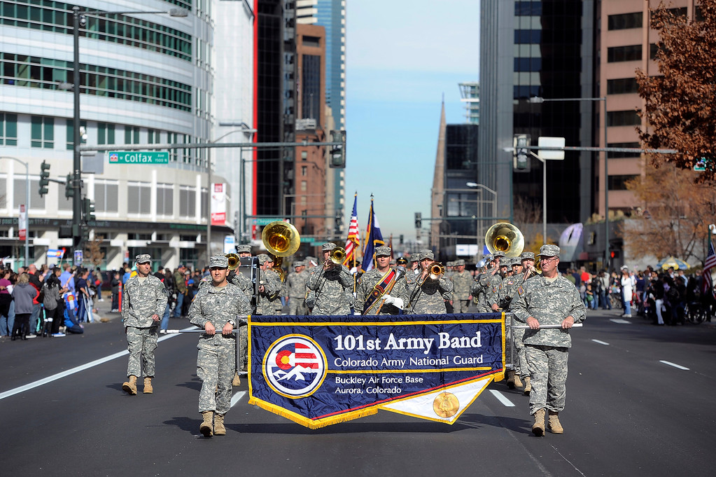 . DENVER, CO - NOV. 9: Members of the 101st Army Band for the Colorado National Guard from Buckley Air Force Base in Aurora head down Broadway during the parade. The largest annual Denver Veteran\'s Day Celebration takes place starting with a 5k run and continuing with a parade and remembrance ceremony downtown next to Civic Center Park, and finishing on the Auraria campus with activities and fireworks. (Photo By Kathryn Scott Osler/The Denver Post)