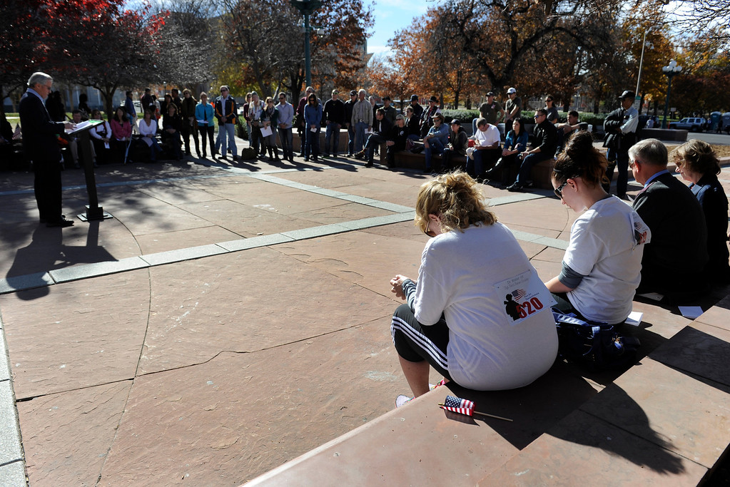 . DENVER, CO - NOV. 9: A small crowd gathers at the Colorado Veterans Monument in Veterans-Lincoln Park to hear the names read of all Colorado Iraq and Afghanistan war dead during a special ceremony after the parade. The largest annual Denver Veteran\'s Day Celebration takes place starting with a 5k run and continuing with a parade and remembrance ceremony downtown next to Civic Center Park, and finishing on the Auraria campus with activities and fireworks. (Photo By Kathryn Scott Osler/The Denver Post)
