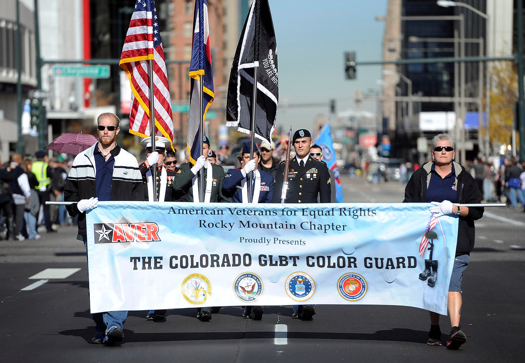 . DENVER, CO - NOV. 9: Members of The Colorado GLBT Color Guard walk down Broadway during the parade. The largest annual Denver Veteran\'s Day Celebration takes place starting with a 5k run and continuing with a parade and remembrance ceremony downtown next to Civic Center Park, and finishing on the Auraria campus with activities and fireworks. (Photo By Kathryn Scott Osler/The Denver Post)