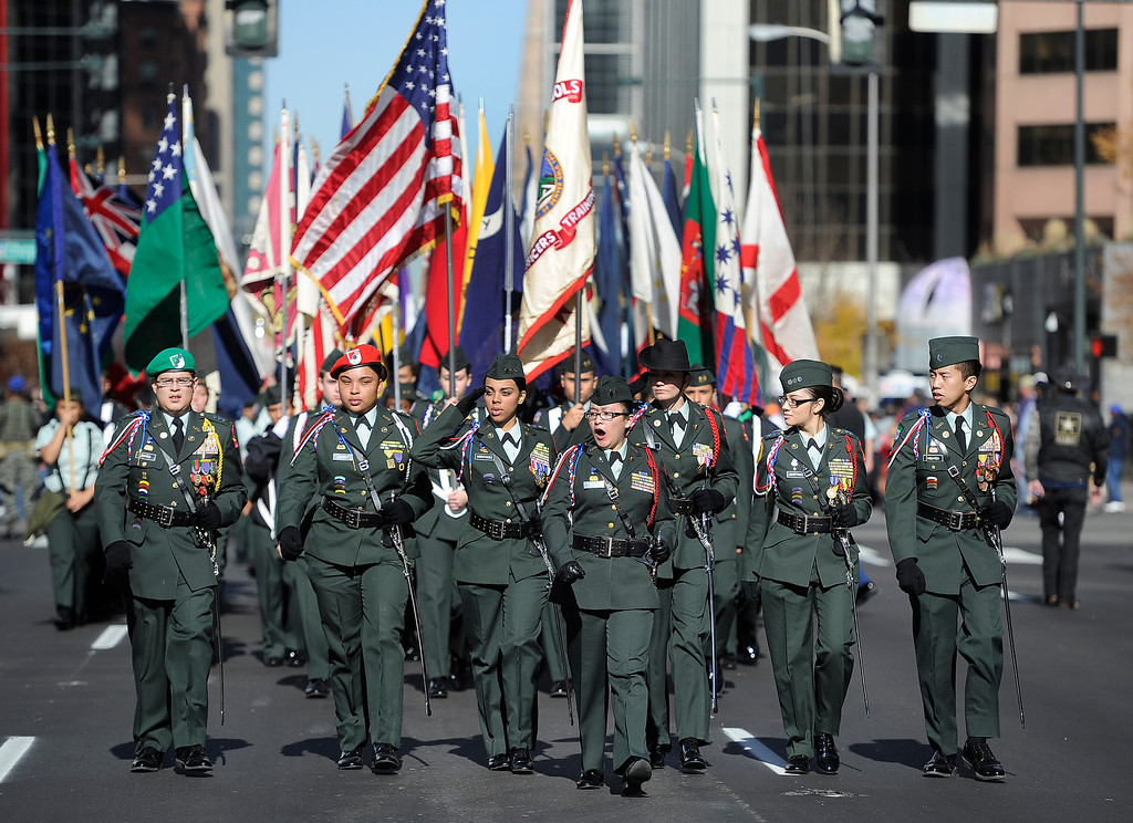 . DENVER, CO - NOV. 9: The Denver Public School ROTC Brigade makes their way down Broadway during the parade. The largest annual Denver Veteran\'s Day Celebration takes place starting with a 5k run and continuing with a parade and remembrance ceremony downtown next to Civic Center Park, and finishing on the Auraria campus with activities and fireworks. (Photo By Kathryn Scott Osler/The Denver Post)