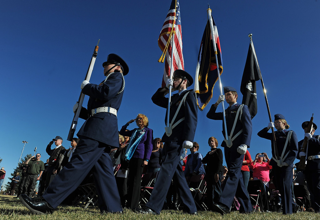 ". Members of the Broomfield Composite Squadron Civil Air Patrol had the honor of presenting the colors during the 36th annual Remembrance ceremony of Veteran\'s Day at Fort Logan Cemetery in Lakewood, CO  on November 11, 2013. The day was marked with a 21 gun rifle salute, ""Echo taps\"" played by buglers and the release of white birds of freedom.  The benediction was given by Jackie Newlander.  (Photo By Helen H. Richardson/ The Denver Post)"