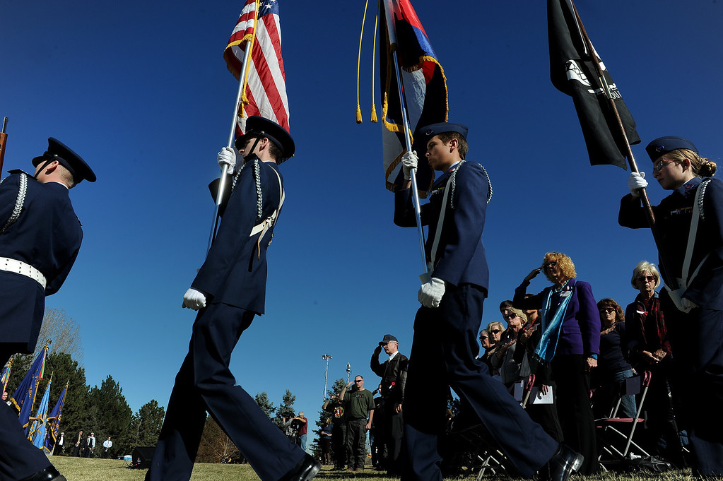 ". LAKEWOOD, CO - NOVEMBER 11, 2013: Members of the Broomfield Composite Squadron Civil Air Patrol had the honor of presenting the colors during the 36th annual Remembrance ceremony of Veteran\'s Day at Fort Logan Cemetery in Lakewood, CO  on November 11, 2013. The day was marked with a 21 gun rifle salute, ""Echo taps\"" played by buglers and the release of white birds of freedom.  The benediction was given by Jackie Newlander.  (Photo By Helen H. Richardson/ The Denver Post)"