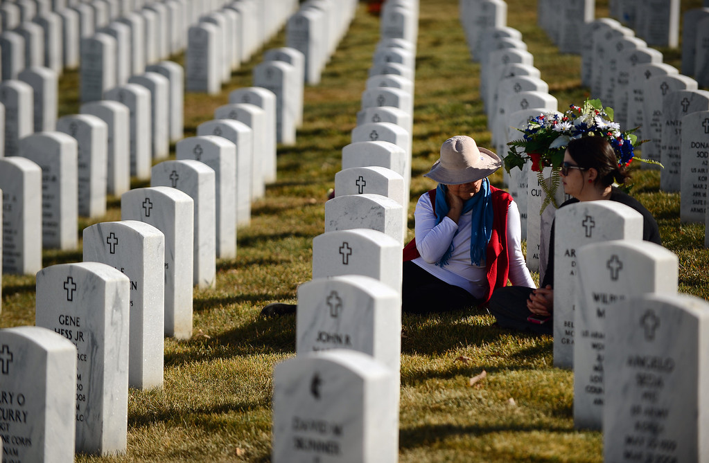 . LAKEWOOD, CO - NOVEMBER 11, 2013: Trisha Bosak middle, visits the gravesides of her parents with her daughter Katie Edwards, right . after the 36th annual Remembrance ceremony of Veteran\'s Day at Fort Logan Cemetery in Lakewood, CO  on November 11, 2013.  (Photo By Helen H. Richardson/ The Denver Post)