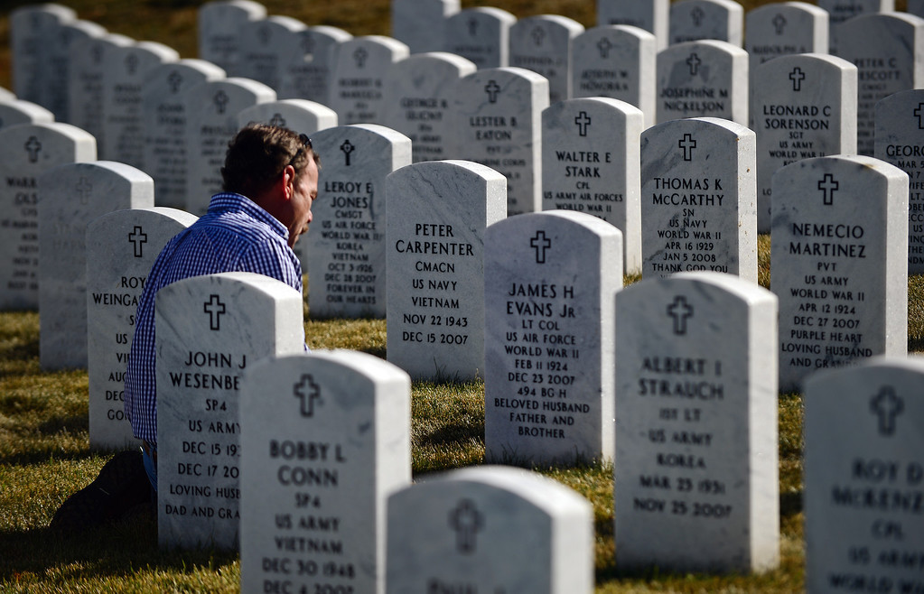 . LAKEWOOD, CO - NOVEMBER 11, 2013: Jim Evans, of Greeley, Co visits the grave site of his father James H. Evans, Jr. after the 36th annual Remembrance ceremony of Veteran\'s Day at Fort Logan Cemetery in Lakewood, CO  on November 11, 2013. His father was a Lieutenant Colonel in the US. Air Force and served in WWII. He died in 2007.    (Photo By Helen H. Richardson/ The Denver Post)