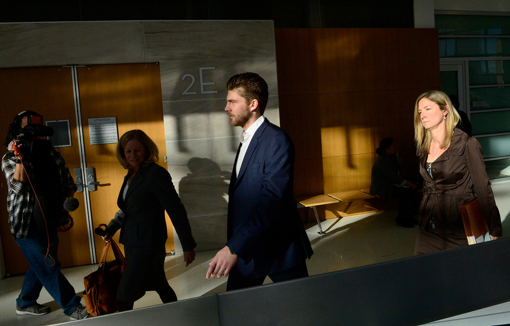 . Semyon Varlamov, starting goaltender for the Colorado Avalanche, leaves court after his hearing in Denver, December 02, 2013. Varlamov was in court for an advisement hearing related to a misdemeanor assault charge after his girlfriend said he attacked her. (Photo by RJ Sangosti/The Denver Post)