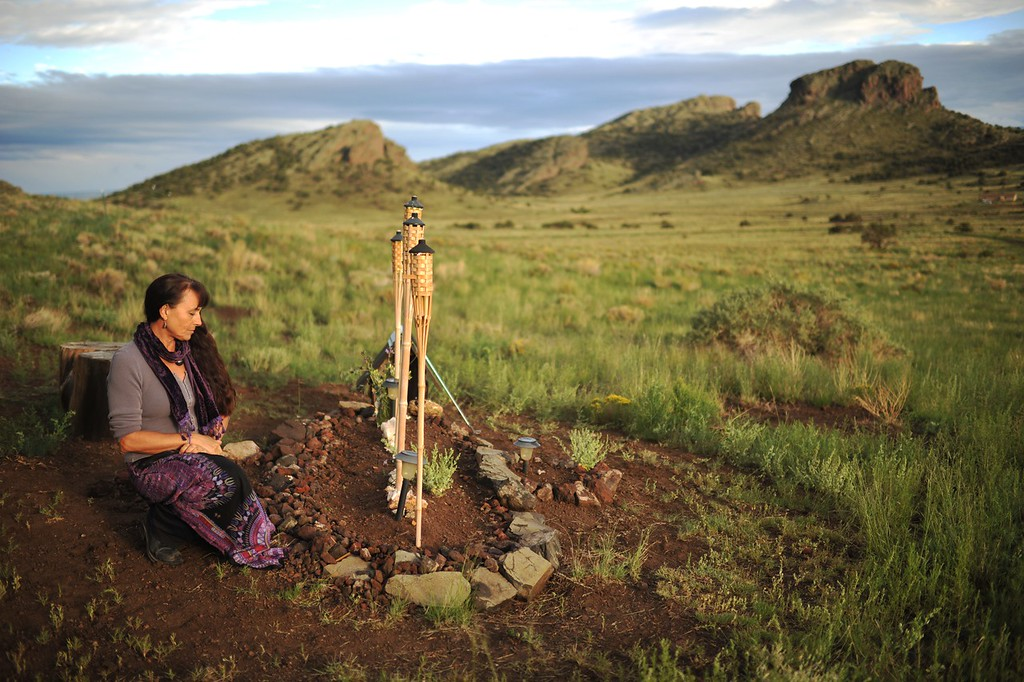 . DEL NORTE, CO. - August 07: KimAnna Cellura-Shields stops by the grave of her father Charles Cellura. Del Norte, Colorado. August 07, 2013. KimAnna Cellura-Shields had buried her father on her property in the spring of 2012. Back at Angel Rock Ranch, Charles Cellura�s two dogs were buried next to him, one on each side when they passed away a few month after their master�s death. (Photo By Hyoung Chang/The Denver Post)