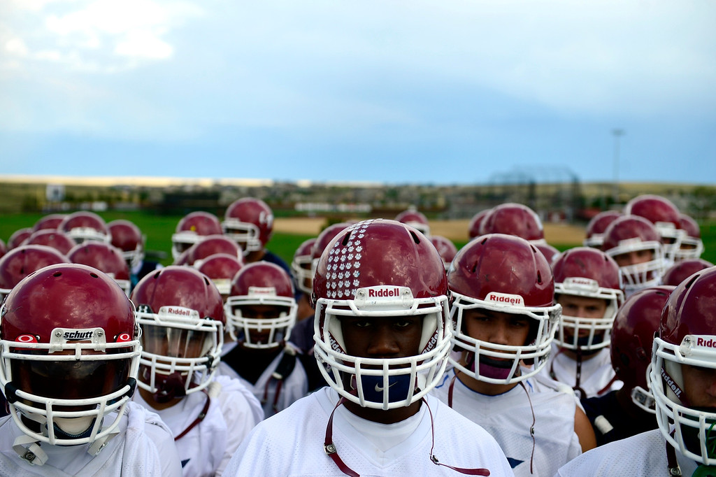 . AURORA, CO - AUGUST 12: The Cherokee Trail football team listens to head coach Monte Thelen during the first day of practice. Cherokee Trail lost to Valor Christian in last year\'s 5A state title game. (Photo by AAron Ontiveroz/The Denver Post)